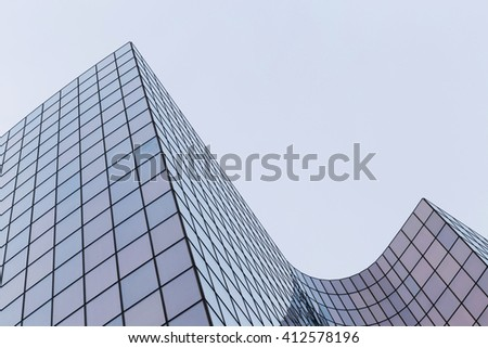 Skyscrapers with glass facade. Modern buildings in Paris business district. Concepts of economics, financial, future.  Copy space for text. Dynamic composition #412578196