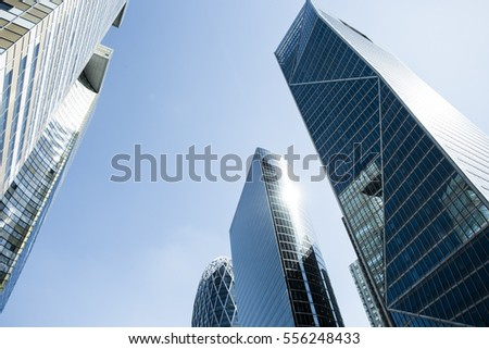 Skyscrapers with glass facade. Modern buildings in Paris business district. Concepts of economics, financial, future.  Copy space for text. Dynamic composition. Toned #556248433