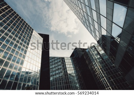 Skyscrapers with glass facade. Modern buildings in Paris business district. Concepts of economics, financial, future.  Copy space for text. Dynamic composition. Toned #569234014