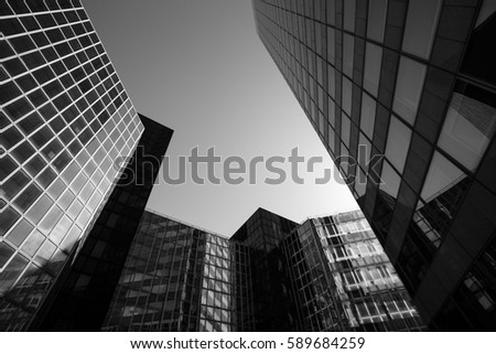 Skyscrapers with glass facade. Modern buildings in Paris business district. Concepts of economics, financial, future.  Copy space for text. Dynamic composition. Toned #589684259