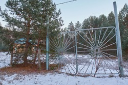 Slanted Gate of the abandoned young pioneer camp.