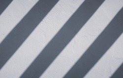 slanted shadow stripes on white wall