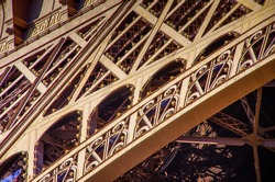 Slanted view of the Eiffel Tower in Paris, detailed view of the iron structures. High quality photo