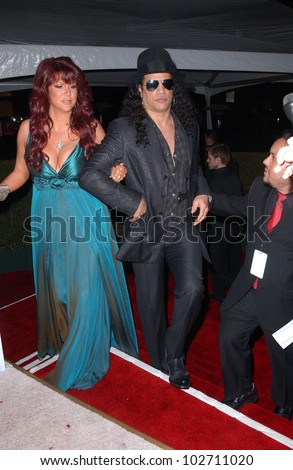 Slash and wife Perla at the 18th Annual Elton John AIDS Foundation Oscar Viewing Party, Pacific Design Center, West Hollywood, CA. 03-07-10
