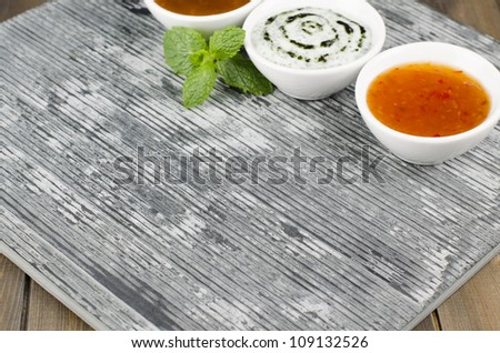 Slate & Dips - Empty slate serving dish with mango chutney, mint raita and chili sauce with mint leaves.