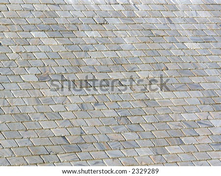 slate roof image with deep shadows between the tiles