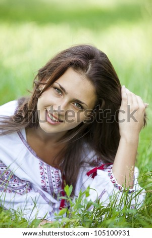 stock photo : Slav teen girl at green meadow in national ukrainian clothing.