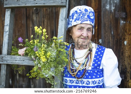 Slavic old woman in ethnic clothes outdoor. Grandmother.