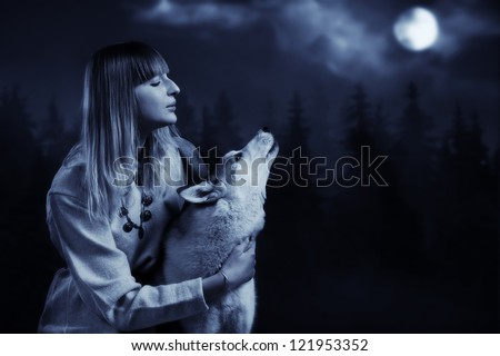 Slavonian girl in the traditional suit and gey wolf in the deep forest
