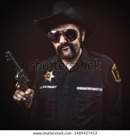 Sleazy southern style sheriff cop smirking or chewing tobacco with a greasy mustache, cowboy hat, and pistol.
