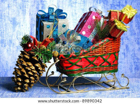 Sledge with gifts and toys to a Christmas fir-tree