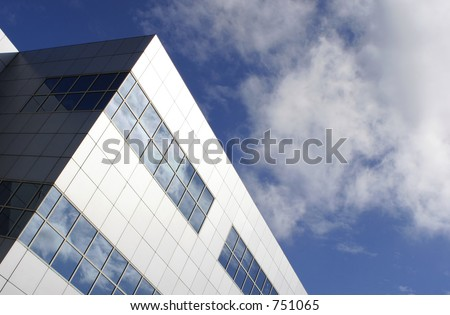 Sleek modern office block with aluminum facade __ with room for text