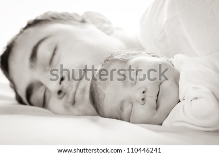 Sleep baby with dad, closeup faces