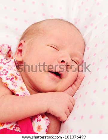 Sleeping and smiling cute and funny baby girl