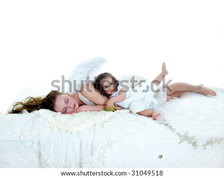 Sleeping angel with one year old girl on white mattress isolated on white