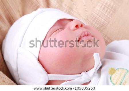 sleeping baby boy over light beige textured