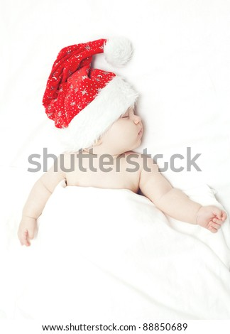sleeping baby in santa's hat