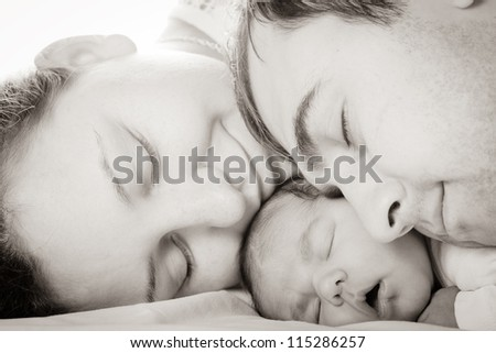 Sleeping baby with mom and dad, closeup faces