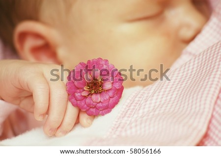 Sleeping baby with pink flower