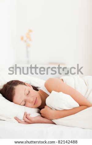 Sleeping beautiful woman in her bedroom