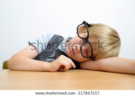 sleeping boy with nerd glasses