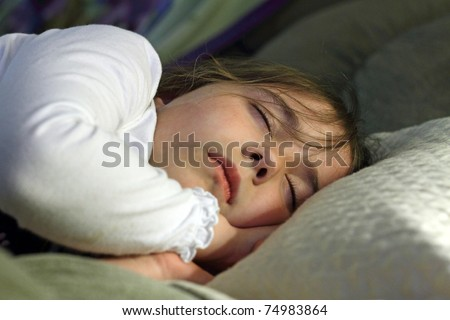 Sleeping child on couch