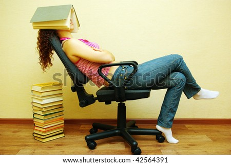 Sleeping female student with book on head