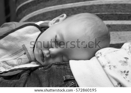 Sleeping infant male portrait #572860195