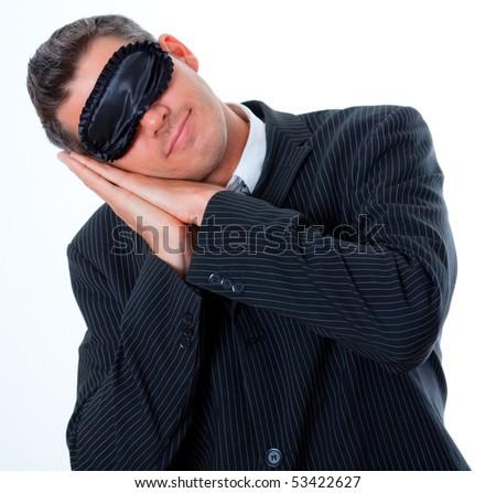 Sleeping mask wearing business man