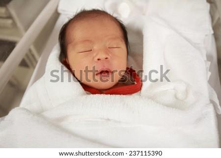 Sleeping new born baby (Japanese girl)