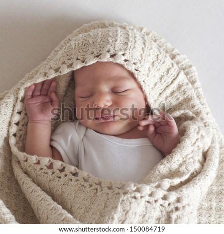 Sleeping newborn baby, boy or girl, close up.