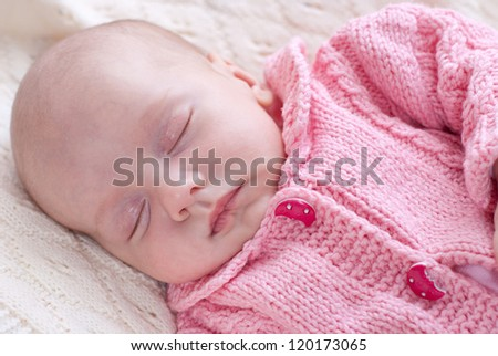 Sleeping newborn baby girl.