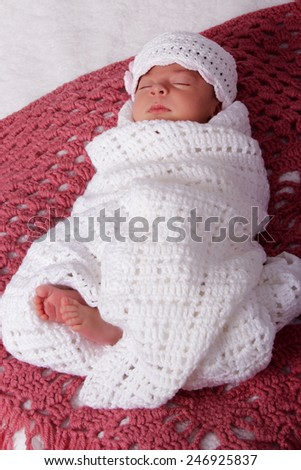 Sleeping newborn baby girl in hat with flowers. Tenderness, health, new life