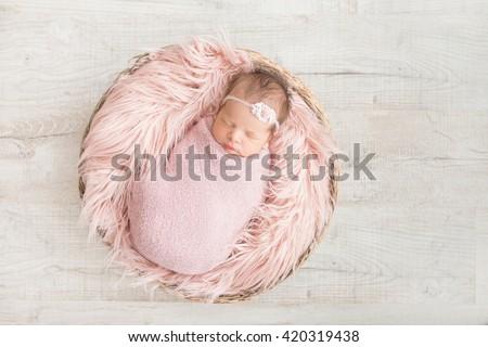 Stock Photo sleeping newborn baby in a basket