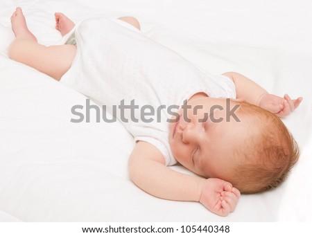 Sleeping Newborn Baby on White Bed Sheet
