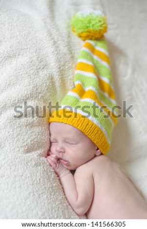 sleeping newborn in funny hat