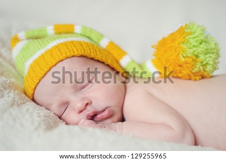 sleeping newborn wearing funny hat