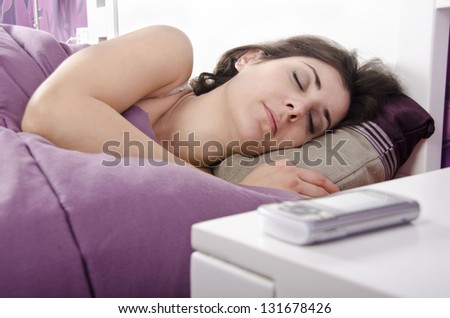 Sleeping next to phone (focus is in girl)