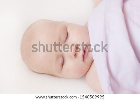 Sleeping peaceful innocent tender baby infant under the blanket #1540509995