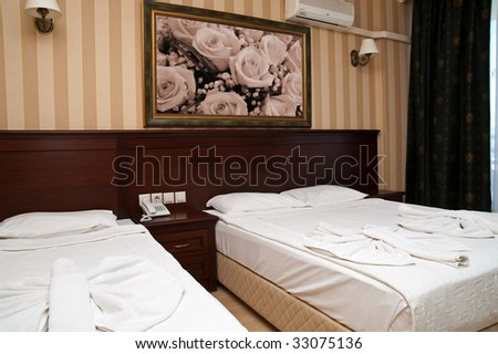 Sleeping room in a hotel Photograph on the wall made by author