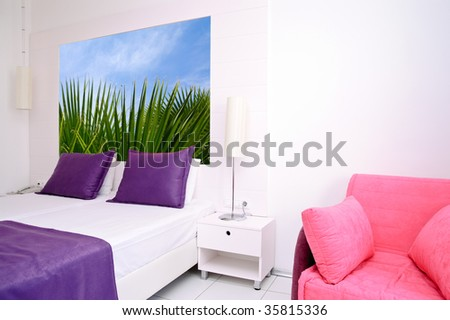 Sleeping room in a hotel. Photograph on the wall made by author