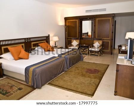 Sleeping room with two beds and TV-set