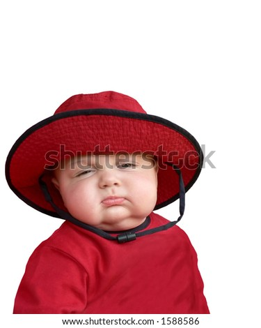 Sleepy baby in red hat.