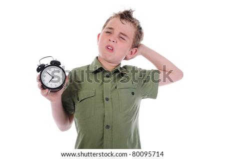 Sleepy boy with alarm-clock isolated on white background