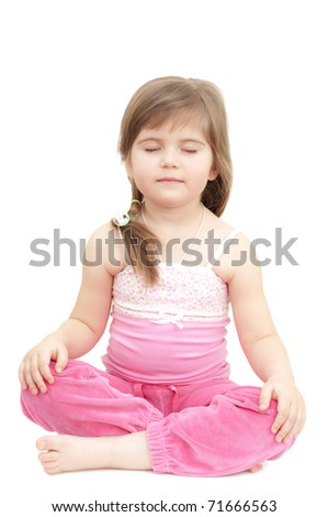 sleepy little girl sits like a turk on white