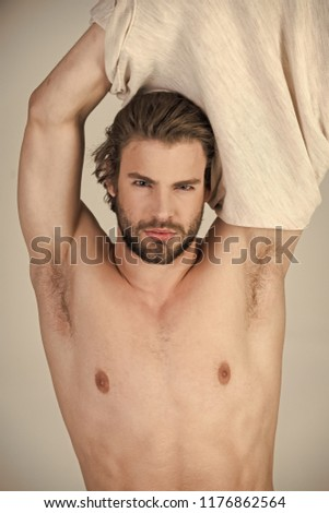 Sleepy man undress on grey background. Man with disheveled hair in underwear. Barber and hairdresser, male fashion. Insomnia, energy, single with uncombed hair. Morning wake up, everyday life.