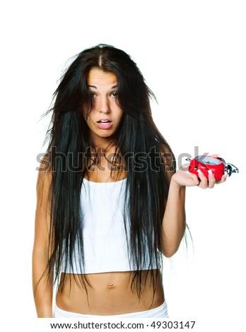 Sleepy woman with the alarm clock on whute background