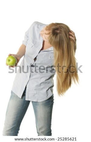 Slender young woman with green apple bending head - stock photo