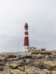 Sletringen Lighthouse, located at the small fishing village, Titran, in Norway. Sletringen is the tallest lighthouse in Scandinavia, and was built in 1923. Photo was taken on public ground, 31.07.2020