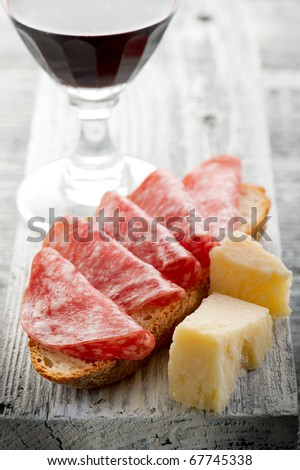 slice bread with salami  grana and wine